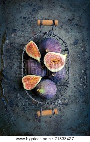 Figs In A Basket On Rustic Metal Background