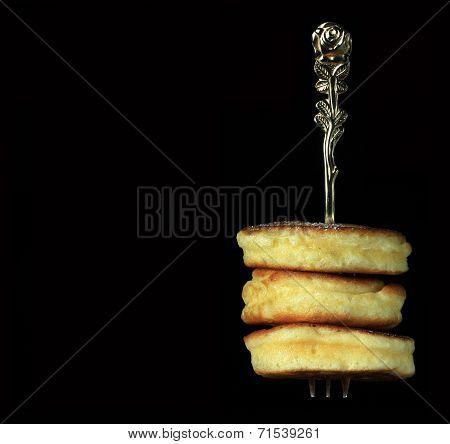 Freshly baked mini pancakes on fork