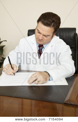 Doctor Writes In Chart