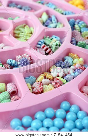 Multicoloured beading kit for children in a pink box