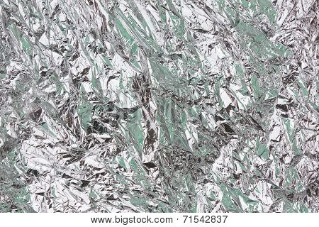 Abstract Crumpled Silver Aluminum Foil Closeup Background Texture