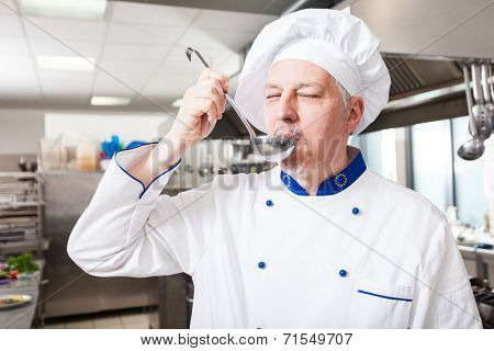 Chef tasting food in his kitchen