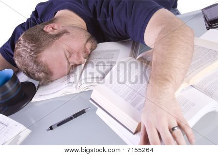 College Student Sleeping On His Desk