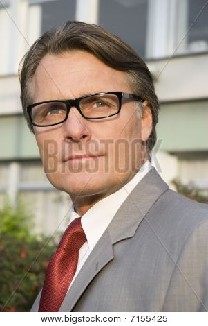 pensive looking forties businessman