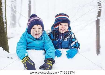 Happy Family: Two Little Twin Boys Having Fun With Snow In Winter Forest.