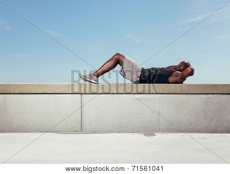 Muscular Young Man Doing Sit-ups