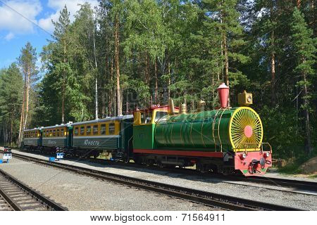 NOVOSIBIRSK, RUSSIA - AUGUST 20, 2014: Train on the station Sportivnaya of Children's railway. Built in 2005 for about $9 millions, it is one of the best children's railroad in Russia