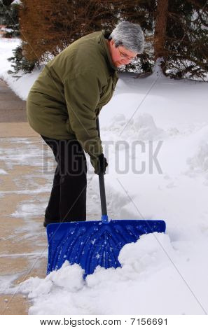 Middle Aged Woman Shoveling