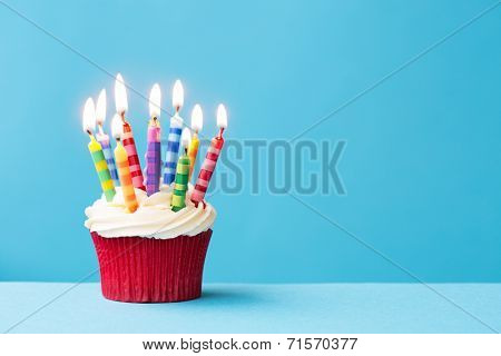 Birthday cupcake against a blue background