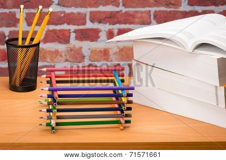 Desk With School Supplies And Colored Pencil