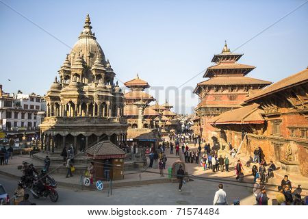 KATHMANDU, NEPAL - DEC 5, 2013: View of the Patan Durbar Square - it is one of the 3 royal cities in the Kathmandu, a very popular spot for tourists.