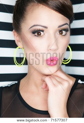 Attractive young surprised woman  on stripy background, beauty and fashion concept