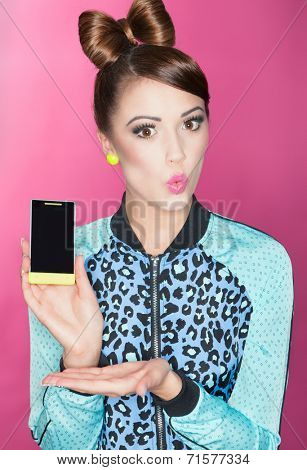 Young attractive brunette woman presenting a smart phone