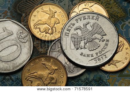 Coins of Russia. Saint George killing the Dragon depicted in Russian kopek coins and Russian two-headed eagle at roubles coin.