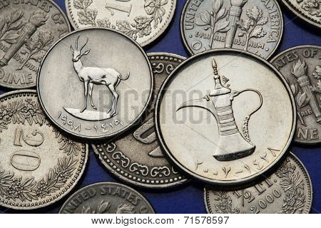 Coins of the United Arab Emirates. Sand Gazelle (Gazella subgutturosa marica) and an Arab tea pot depicted in UAE dirham coins.
