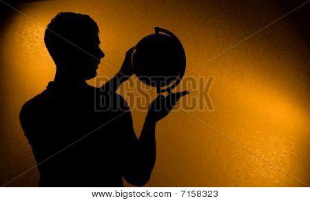 Silhouette Of Man Holding Globe