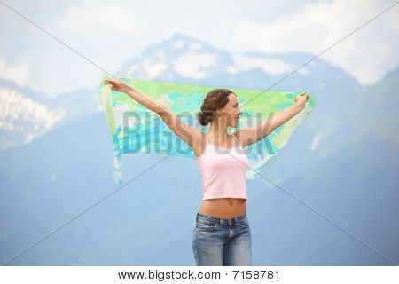 beautiful joyful woman with kerchief is looking away.
