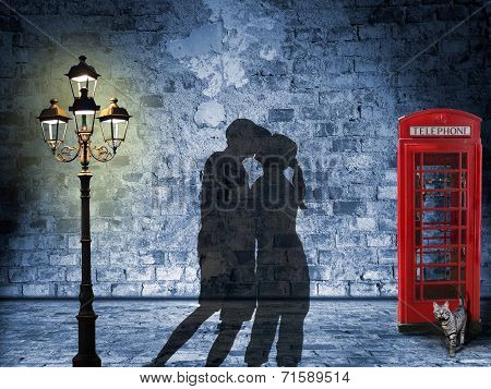 Kissing Couple Silhouette In The Streets Of London, Night Scenery With Glooming Lantern And British