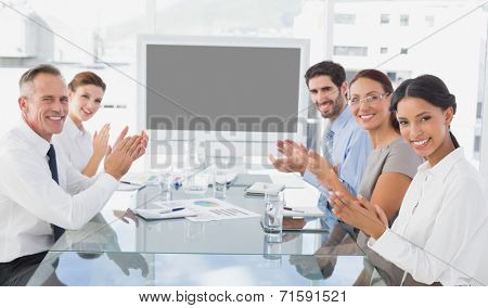 Business colleagues giving applause in a meeting