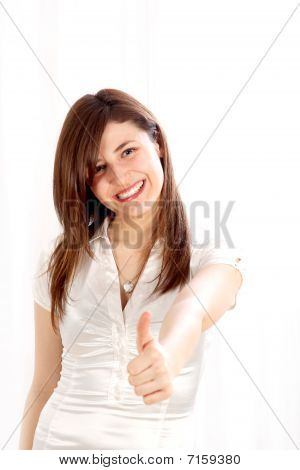 Young, Positive Woman Shows Her Smiling Thumbs-up.