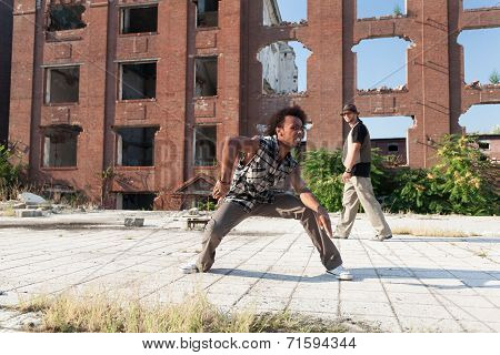 Two Young Men Street Dancing In A City Square