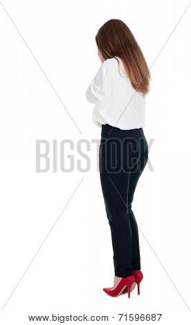 Back view of shocked woman in trousers. girl hid his eyes behind his hands.  Rear view people collection.  backside view of person.  Isolated over white background.