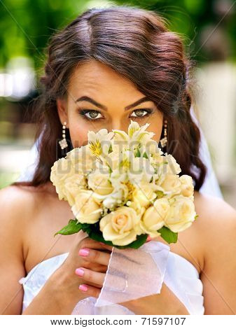 Bride with flower park outdoor.