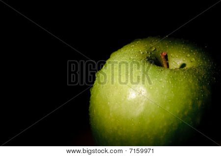 Granny Smith apple on black