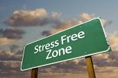 image of stress relief  - Stress Free Zone Green Road Sign In Front of Dramatic Clouds and Sky - JPG