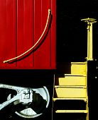 stock photo of caboose  - This is an artistic shot of  a red caboose contrasting with yellow steps - JPG