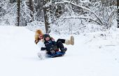 picture of sleigh ride  - Mother And Son Enjoying A Sleigh Ride On A Beautiful Winter Day - JPG