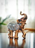 stock photo of indian elephant  - Golden indian elephant on table - JPG