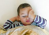 stock photo of sleepy  - Sleepy child in the bed waking up or getting sleep - JPG