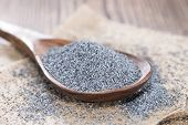 stock photo of opiate  - Wooden Spoon with a small portion of Poppyseed  - JPG