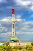 stock photo of oilfield  - Land oil drilling rig on oilfield in Texas - JPG
