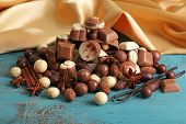 foto of bonbon  - Different kinds of chocolates on wooden table close - JPG