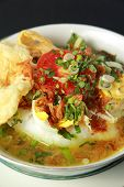 stock photo of ayam  - Indonesian chicken porridge or bubur ayam - JPG