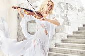 stock photo of violin  - Beautiful blond hair woman with violin - JPG