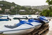 picture of waverunner  - Row of blue and grey waverunners on a beach - JPG