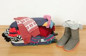 picture of carry-on luggage  - Packing the suitcase for Christmas vacation - JPG