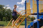 Boy And Playground Equipment