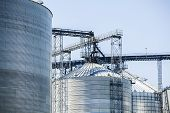 foto of silos  - Upper part of huge silver shiny agricultural silos - JPG