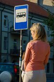 picture of bus-shelter  - Young sexy woman waiting for the bus - JPG