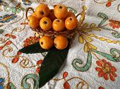 foto of loquat  - Loquat fruits on the table on the authentic Turkish tablecloth - JPG