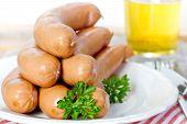 foto of wieners  - wiener sausages on white plate on wooden table  - JPG