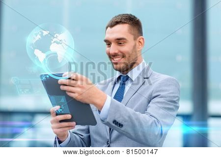 business, education, technology and people concept - smiling businessman working tablet pc computer, virtual screens and globe hologram on city street