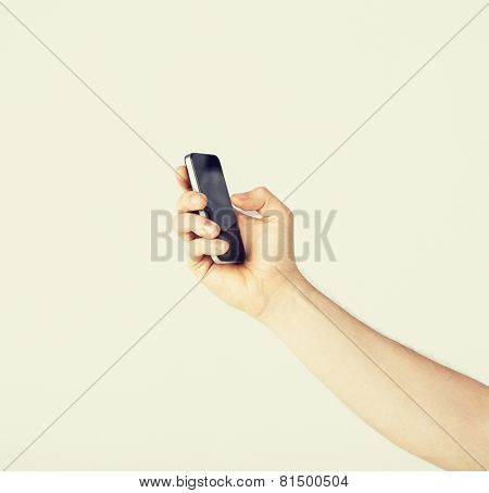 close up of man with smartphone typing something
