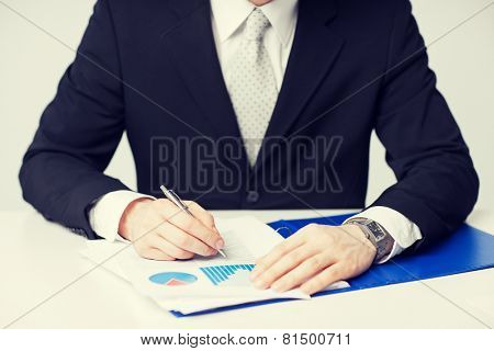 picture of businessman working and signing papers