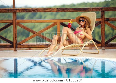 Beautiful Woman Enjoing By The Swimming Pool