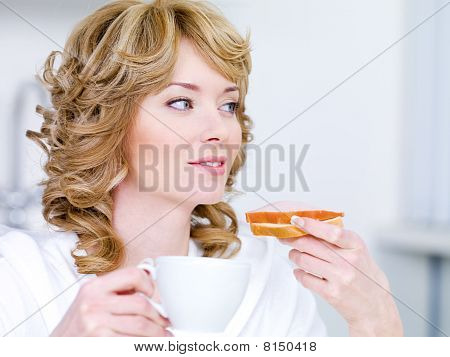Woman With Coffee And Sandwich